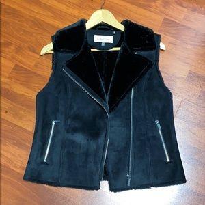 Black Calvin Klein vest.